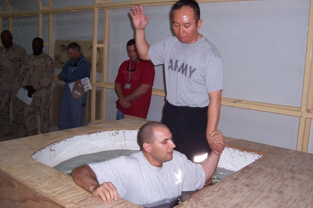 Chaplain Maj. Cho performing a baptism, Iraqi Freedom 2005