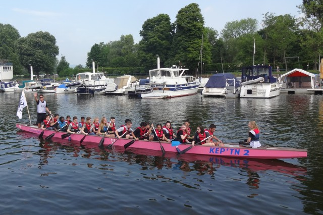 Teachers, staff and students of the Erich Kästner-Schule hosted Wiesbaden military community students for a morning of dragon boat racing, May 30, in Wiesbaden, Germany.   The event, in its third year, teams up students from the Erich Kästner-Schule with Wiesbaden middle and high school students. Students work together to propel their boat and overtake their competition.