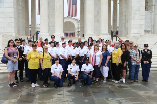 Active duty Soldiers in IMCOM's Better Opportunities for Single Soldiers program, or BOSS, and Gold Star survivors take a moment together to remember their visit to Arlington National Cemetery 28 May 2018. The U.S. Army Installation Management Command organized this annual trip to show their support for survivors, who are considered forever members of the Army Family.