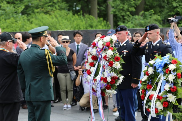 Active duty Soldiers, salute as they place a wreath at the Korean War Memorial on Memorial Day 29 May 2017, to show their respect for those who died in the service of their nation.  The U.S. Army Installation Management Command sponsored the annual trip which included Soldiers stationed in Japan, Hawaii and several other states around the country. Also participating in the ceremony were veterans from the Korean War and officers in the Korean Army.