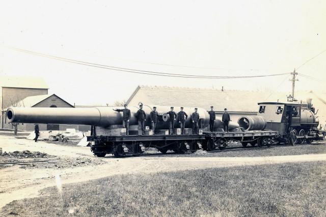 The first 16-inch gun is being readied for barge shipment in 1902.