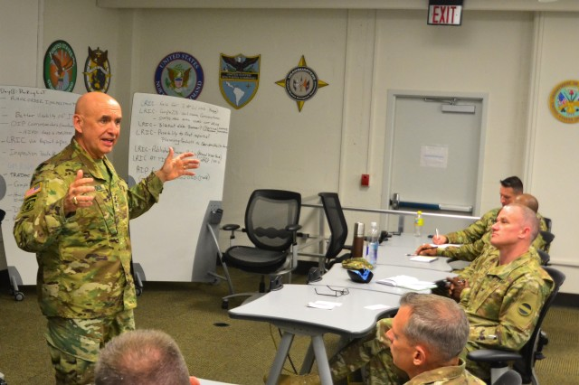 Lt. Gen. David E. Quantock, left, the Army inspector general, speaks to attendees at the annual IG conference, held April 25 through 27 at Humphreys Hall at Fort Belvoir, Virginia. The conference also included remarks from Kenneth P. Moorefield, the deputy IG for the Special Plans and Operations Division at the Department of Defense Office of the Inspector General; and Sgt. Maj. of the Army Daniel A. Dailey.