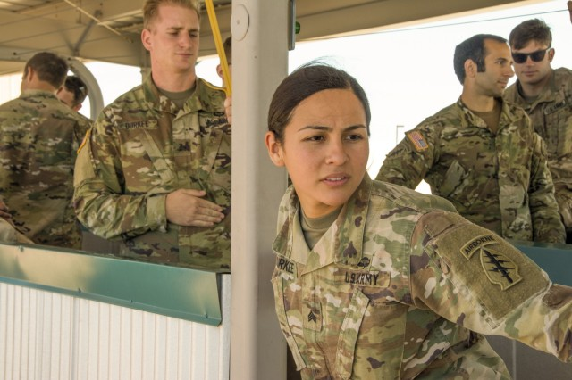 "Sgt. Angel Durkee, an intelligence analyst assigned to the 10th Special Forces Group (Airborne), practices leaning outside of an aircraft during a static-line jumpmaster course held in May at Fort Carson, Colo. Students in the course were evaluated on their ability to lead airborne operations from within the aircraft. Angel, along with her husband Sgt. Daniel Durkee, a mechanic assigned to 10th Group, graduated from the course and earned the title ""Jumpmaster."" (U.S. Army photo by Staff Sgt. Will Reinier)"