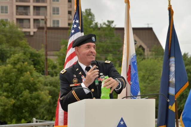 Colonel John H. Garr, executive director of the Borden Institute, addressed the crowd at his retirement ceremony held at the Army Medical Department Museum on Joint Base San Antonio, Fort Sam Houston, on 2 June 2017. (Photo by Michael Watkins, 502 ABW Public Affairs)