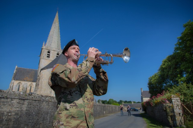 Sgt. Jonathan Bosarge performs Taps during the 73rd D-Day ceremony in Picauville, France.