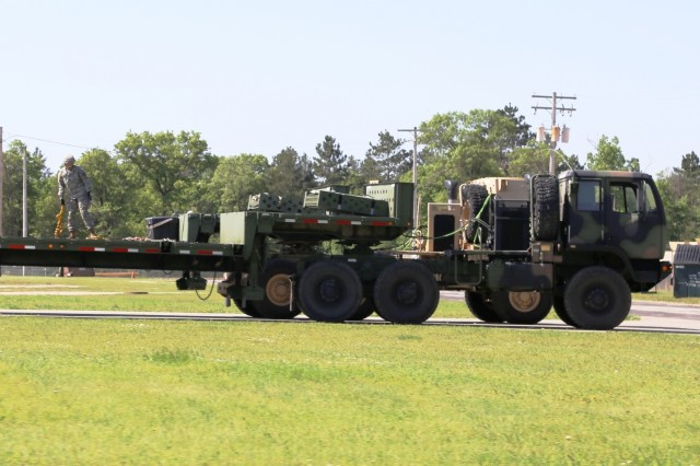 Soldiers at Fort McCoy for training in the Exportable Combat Training Capability (XCTC) Exercise stage equipment for use on June 2, 2017, at Fort McCoy, Wis. This XCTC Exercise is coordinated by the Illinois National Guard's 33rd Infantry Brigade Combat Team and Joint Forces Headquarters-Illinois. The exercise takes place for three weeks in June. XCTC is the Army National Guard's program to provide participants with an experience similar to an Army combat training center at home station or a regional training center, such as Fort McCoy.