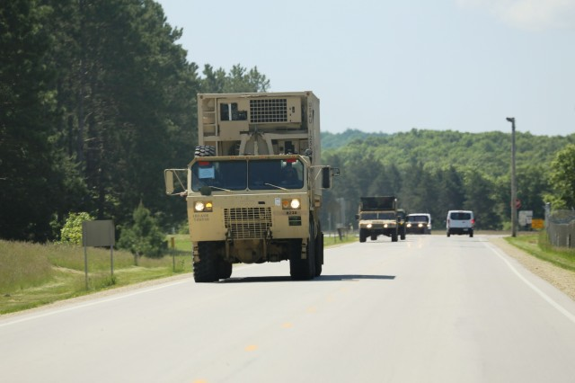 Soldiers at Fort McCoy for training in the Exportable Combat Training Capability (XCTC) Exercise drive vehicles in a convoy on June 2, 2017, at Fort McCoy, Wis. This XCTC Exercise is coordinated by the Illinois National Guard's 33rd Infantry Brigade Combat Team and Joint Forces Headquarters-Illinois. The exercise takes place for three weeks in June. XCTC is the Army National Guard's program to provide participants with an experience similar to an Army combat training center at home station or a regional training center, such as Fort McCoy.