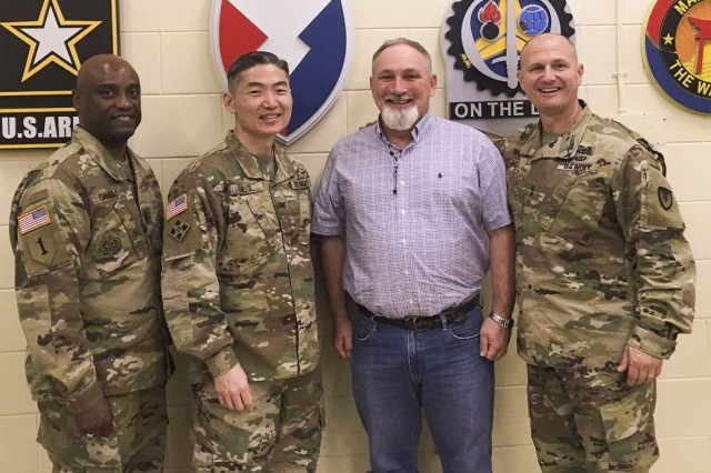 Maj. Gen. Edward M. Daly (right), senior commander, Rock Island Arsenal and commanding general of U.S. Army Sustainment Command; Bobby White, brigade logistics support representative, 403rd Army Field Support Brigade; Col. Michael Siegl, commander, 403rd AFSB; and Command Sgt. Maj. Kendricks Gamble, command sergeant major, 403rd AFSB, participate in an impromptu ceremony to present White with a commander's coin for earning the 2016 Linda J. Villar Logistics Assistance Representative of the Year Award, June 2 at Camp Casey in the Republic of Korea.