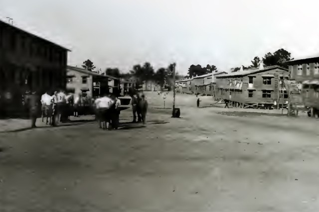 A scene from Camp Jackson, S.C. on Company St. during World War I. Each of those barracks housed 150 Soldiers and 10 of those barracks constituted a regiment.
