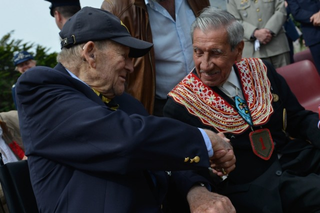 D-Day veterans Charles Shay, right, and George Kline shake hands at the Charles Shay Memorial in Saint Laurent sur Mer, France, June 5, 2017. This ceremony commemorates the 73rd anniversary of D-Day, the largest multi-national amphibious landing and operational military airdrop in history, and highlights the U.S.' steadfast commitment to European allies and partners. Overall, approximately 400 U.S. service members from units in Europe and the U.S. are participating in ceremonial D-Day events from May 31 to June 7, 2017.