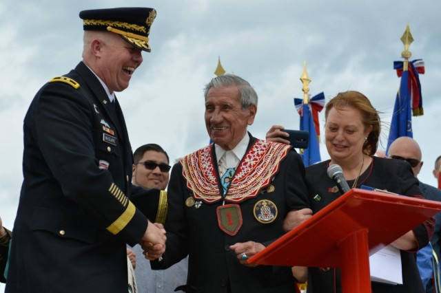 Major General Timothy McGuire, Deputy Commanding General for U.S. Army Europe, and Charles Shay, a Native American D-Day veteran who participated in the liberation of France, shake hands at the Charles Shay Memorial in Saint Laurent sur Mer, France, June 5, 2017. This ceremony commemorates the 73rd anniversary of D-Day, the largest multi-national amphibious landing and operational military airdrop in history, and highlights the U.S.' steadfast commitment to European allies and partners. Overall, approximately 400 U.S. service members from units in Europe and the U.S. are participating in ceremonial D-Day events from May 31 to June 7, 2017.