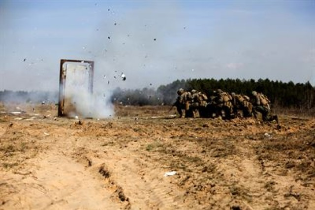 U.S. Marines with Black Sea Rotational Force 17.1 and NATO allies stack up during breach training as part of Exercise Summer Shield at Adazi Military Base, Latvia, April 20, 2017. Exercise Summer Shield is a multinational NATO exercise.