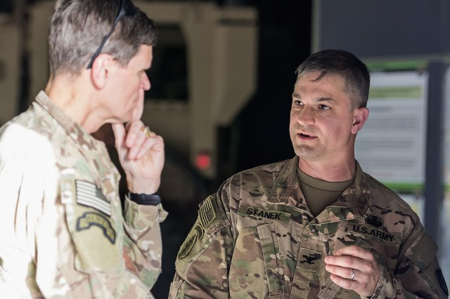 Col. Aaron Stanek (right), commander, 401st Army Field Support Brigade speaks with U.S. Central Command Commanding General, Army Gen. Joseph L. Votel about maintenance and modernization of Army Prepositioned Stocks-5 heavy equipment during an APS-5 warehouse tour at Camp Arifjan, Kuwait, June 3. (U.S. Army photo by Justin Graff, 401st AFSB Public Affairs)
