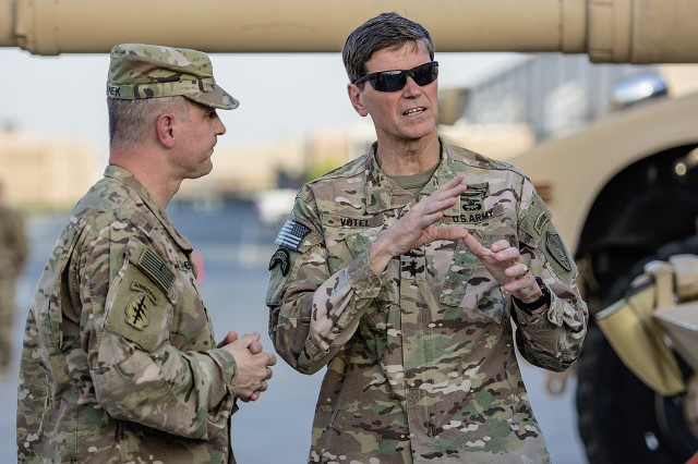 U.S. Central Command Commanding General, Army Gen. Joseph L. Votel (right) discusses maintenance and modernization of Army Prepositioned Stocks-5 heavy equipment with Col. Aaron Stanek, commander, 401st Army Field Support Brigade during a tour of the facility at Camp Arifjan, Kuwait, June 3. (U.S. Army photo by Justin Graff, 401st AFSB Public Affairs)