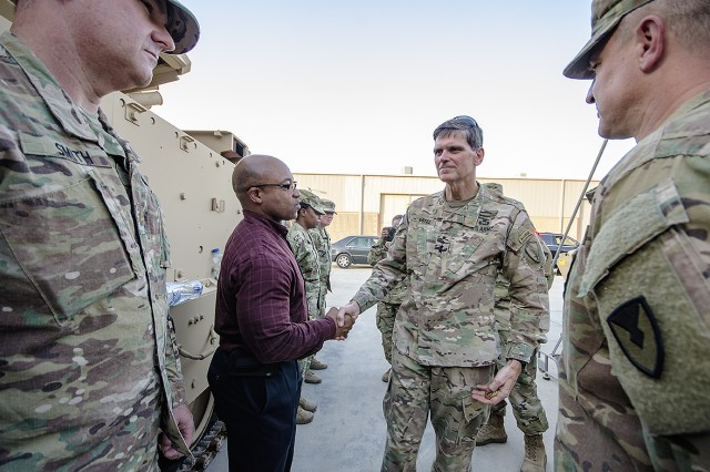 U.S. Central Command Commanding General, Army Gen. Joseph L. Votel thanks 401st Army Field Support Brigade personnel at the end of an Army Prepositioned Stocks-5 warehouse tour at Camp Arifjan, Kuwait, June 3. (U.S. Army photo by Justin Graff, 401st AFSB Public Affairs)