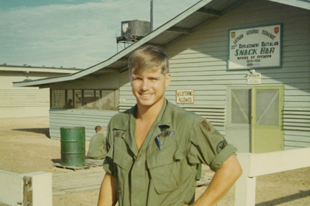 U.S. Army Pfc. James McCloughan, posing in front of the Vietnam Regional Exchange Snack Shop, 1969.