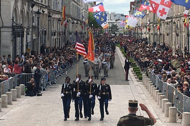 US Army color guard marches in parade marking World War I liberation of Orleans