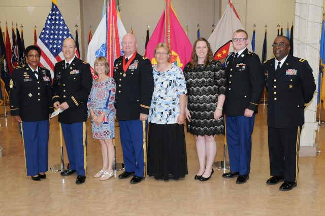 Left to right: Command Sgt. Maj. Tomeka O'Neal, Col. Paul Walenesky, Betty Walenesky, Col. Eric Holliday, Teresa Holliday, Erica Holliday, Thomas Holliday and Brig. Gen. Richard Dix, pose for a picture during the official Retirement Ceremony for both officers at the Rock Island Arsenal, June 2.
