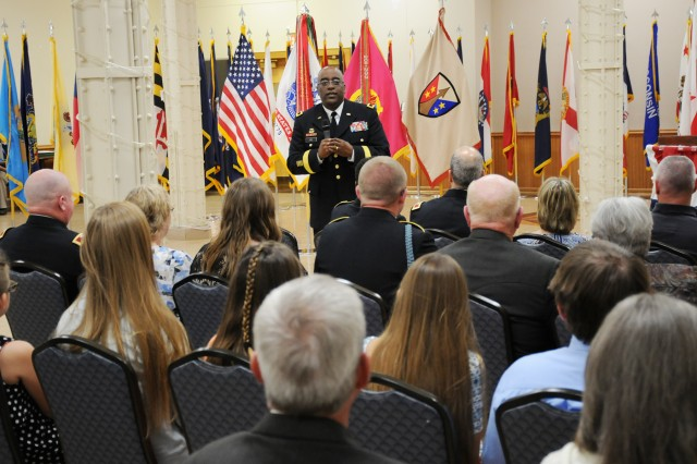 Brig. Gen. Richard Dix, commander, Joint Munitions Command, provides remarks to Col. Walenesky, Col. Holliday, and their Family members during the official Retirement Ceremony for both officers at the Rock Island Arsenal, June 2.