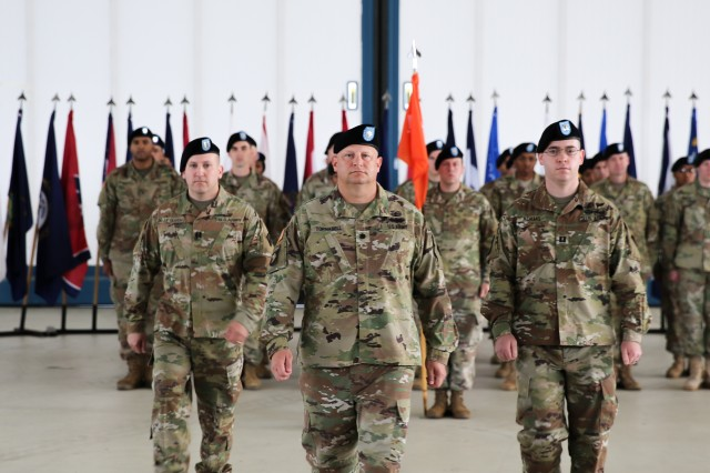U.S. Army Capt. Matthew de la Guardia, outgoing commander of the U.S. Army Signal Activity Kaiserslautern; Lt. Col. Ernest Tornabell IV, commander 102nd Signal Battalion, 2nd Theater Signal Brigade; and Capt. Dominic Adams, incoming USASA-K commander, return to their posts after the passing of the unit colors during a company change of command ceremony June 5, 2017, Landstuhl, Germany.