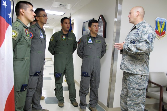 U.S. Air Force Master Sgt. Austin Blessard, Weapons and Tactics non-commissioned officer in charge, with the Georgia Air National Guard's 117th Air Control Squadron at Hunter Army Airfield, introduces himself to members of the Colombian air force during a State Partnership Program Subject Matter Expert Exchange on Ground Control Intercept with the Georgia Air National Guard, May 30-June 2, 2017. During the week-long engagement the Colombians worked with Air Controllers from 117th shaping Colombian air force training plans by pairing experts together to exchange ideas. The Georgia Air National Guard supported the South Carolina National Guard's State Partnership Program during the engagement.