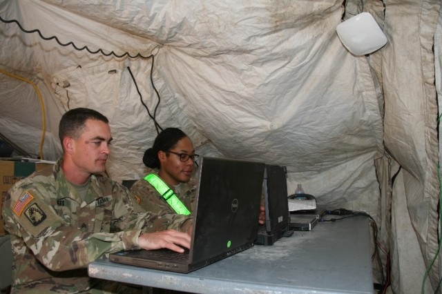 Soldiers from the 1st Armored Brigade Combat Team, 3rd Infantry Division (1/3 ID) demonstrate Secure Wireless capability in the brigade main command post as part of a pilot of the capability during the unit's training rotation at the National Training Center, at Fort Irwin, California, in April 2017.