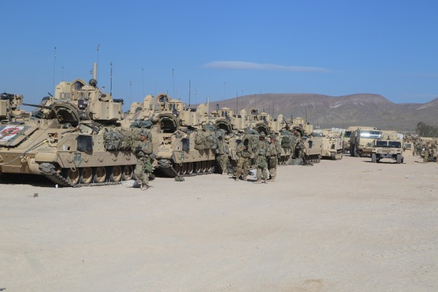 U.S. Army Soldiers with 1st Brigade Combat Team, 3rd Infantry Division, depart garrison to the desert during Decisive Action Rotation 17-05 at the National Training Center in Fort Irwin, California, March 31, 2017.