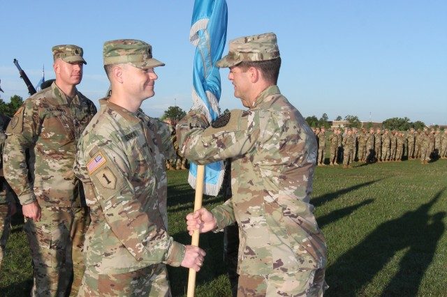 FORT GORDON, Ga. -- Lt. Col. Matt Lennox, commander of the 782nd Military Intelligence (MI) Battalion, officially assumed command when he accepted the battalion colors from Col. Dave Branch, commander of the 780th MI Brigade, on Barton Field Parade Grounds, June 2.