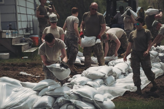 Soldiers of the New York Army National Guard setup barriers of sandbags around homes along the Lake Ontario shoreline after rising water levels have resulted in flooding and a state of emergency being declared on May 2 by Gov. Andrew Cuomo, Kendall, N.Y., May 18, 2017. Members of the New York National Guard have filled more than 240,000 sandbags, which are set up at affected areas such as homes and businesses in the effort to protect them from damage.