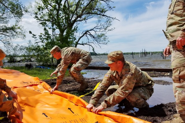New York Army National Guard Soldiers deploy the Tiger Dam flood control system along the shores of Braddock Bay in the Town of Greece, N.Y. in response to rising waters on Lake Ontario. The system consists of flexible fabric tubes which are connected and filled with water. The tubes replace sandbags as a flood control mechanism. Since being ordered to assist in flood mitigation duties by Gov. Andrew M. Cuomo on May 3, New York Army and Air National Guard members, along with members of the New York Naval Militia, have filled more than 673,500 sand bags.