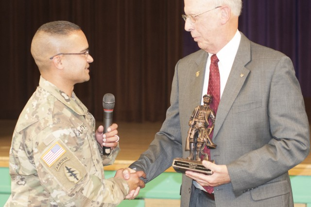 Raymond W. Bliss Army Health Center Commander, Lt. Col.  Edgar G. Arroyo, gives Army Medical Department Civilian Corps Chief, Gregg Stevens, a Buffalo Soldier statue as a token of appreciation for his visit to Fort Huachuca June 6, 2017 (U.S. Army photo by Wendy Arevalo).