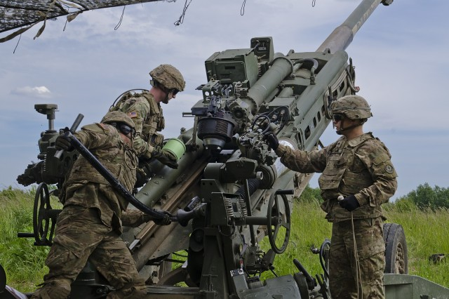 U.S. battle group Soldiers load a M777A2 Howitzer in preparation for a fire mission that was part of a Fire Support Coordination Exercise at Land Forces Field Training Center June 6, 2017. Saber Strike 17 is a U.S. Army Europe-led multinational combined forces exercise conducted annually to enhance the NATO Alliance throughout the Baltic region and Poland. This year's exercise includes integrated and synchronized deterrence-oriented training designed to improve interoperability and readiness of the 20 participating nations' militaries. (U.S. Army photo by Sgt. Justin Geiger)