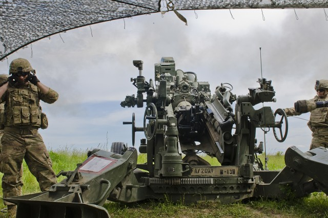 A gun crew executes a fire mission on their M777A2 Howitzer that was part of a Fire Support Coordination Exercise at Land Forces Field Training Center June 6, 2017. Saber Strike 17 is a U.S. Army Europe-led multinational combined forces exercise conducted annually to enhance the NATO Alliance throughout the Baltic region and Poland. This year's exercise includes integrated and synchronized deterrence-oriented training designed to improve interoperability and readiness of the 20 participating nations' militaries. (U.S. Army photo by Sgt. Justin Geiger)
