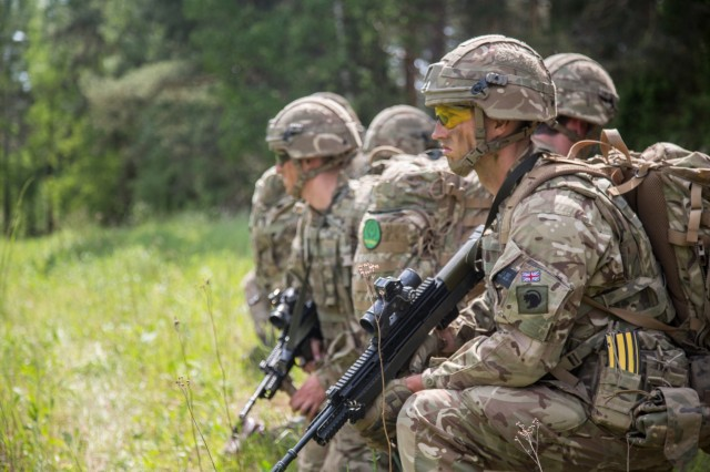 British Soldiers pull security before moving out for the Fire Support Coordination Exercise as part of the Saber Strike exercise at the Bemowo Piskie Training Area in Bemowo Piskie, Poland, June 6, 2017. Saber Strike 17 is a U.S. Army Europe-led multinational combined forces exercise conducted annually to enhance the NATO alliance throughout the Baltic region and Poland. This year's exercise includes integrated and synchronized deterrence oriented training designed to improve interoperability and readiness of the 20 participating nations' militaries. (U.S. Army photo by Spc. Stefan English)