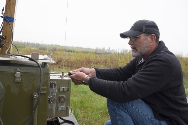 John Kerfien, an electronics work leader with DPTMS' Range Branch, works on an automated target on Range 25.