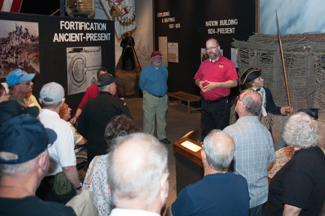 Troy Morgan, Engineer Museum director, leads the Company B, 1st Battalion, 46th Infantry Regiment veterans and their Families on a tour of the Engineer Museum.