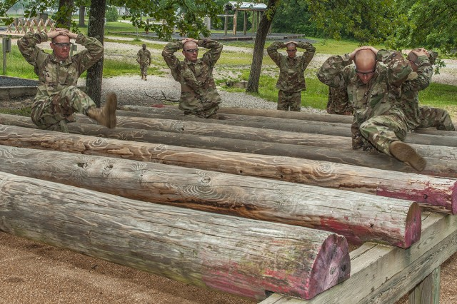 Soldiers in training with Company A, 2nd Battalion, 10th Infantry Regiment, navigate an obstacle on the confidence course as part of a six-week Basic Combat Training cycle for prior-service Soldiers.