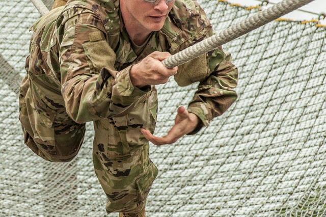 Sgt. Wayne King navigates the slide-for-life obstacle on the confidence course as part of a six-week Basic Combat Training cycle for prior-service Soldiers.
