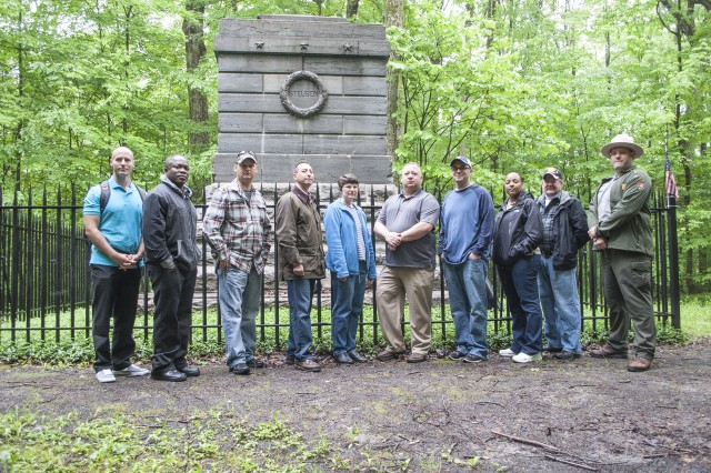 """Soldiers and staff members with the Fort Drum and 10th Mountain Division (LI) Inspector General's Office traveled to Remsen on Monday to visit the New York State Steuben Memorial Historic Site. New York State Park Ranger Dave Bandych gave a tour of the grounds and spoke of Frederich Wilhelm Augustus von Steuben, the first effective U.S. Army inspector general, who authored the first version of the Army """"Blue Book,"""" a manual that outlined standards of military training and organization. From left are Sgt. 1st Class Clayton Lewis, Sgt. 1st Class Henry Agyekum, Master Sgt. Galen Bisel, Lt. Col. Todd Bajakian, Donna Hajdasz, Raymond Gilbert, Sgt. 1st Class Keith Adams, Sgt. 1st Class Felicia Howard, Martin Fineout and Bandych."""