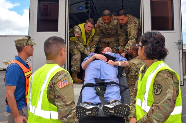 Staff members from Tripler Army Medical Center train to care for hurricane victims during a mass casualty exercise on June 8, 2017 to test emergency response procedures in partnership with U.S. Army Garrison - Hawaii, U.S. Army Health Clinic - Schofield Barracks, the Healthcare Association of Hawaii and other island healthcare facilities.