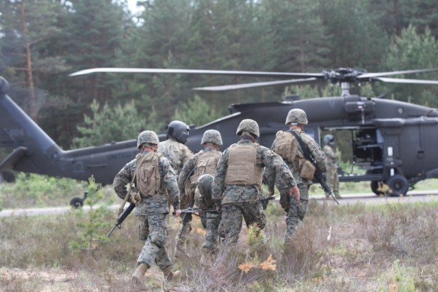 ADAZI, Latvia -Soldiers from Task Force Phoenix, 3rd Brigade, 10th Aviation Regiment, 10th Combat Aviation Brigade, out of Fort Drum, N.Y., provide air transportation in a Medical Evacuation training, or MEDEVAC as the U.S. Marines from U.S. Marine Corps Reserves from 1st Battalion, 23rd Marines out of Louisiana, participate as casualties, during the Saber Strike 17 exercise in Latvia Jun 8. This shows that the 10th CAB is prepared to lead and provide aviation support to regional and global military forces at a moment's notice ensuring mission success through joint and combined training exercises focused on interoperability and conducting unified land operations with the national response forces of our Allies and partners. The Saber Strike exercise program facilitates cooperation and improves joint operational capability in a variety of missions and prepare the participating nations and units for future operations while enhancing the NATO Alliance. (U.S. Army photo by Staff Sgt. Jill People)