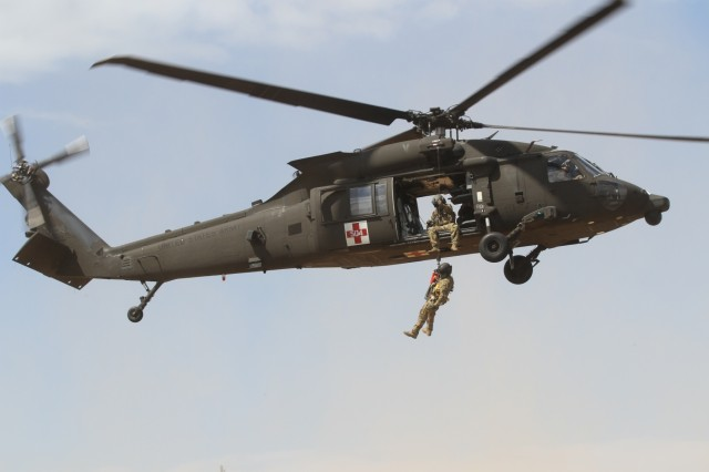 ADAZI, Latvia - Soldiers from Task Force Phoenix, 3rd Brigade, 10th Aviation Regiment, 10th Combat Aviation Brigade, out of Fort Drum, N.Y., provide air transportation in a Medical Evacuation training, or MEDEVAC as the U.S. Marines from U.S. Marine Corps Reserves from 1st Battalion, 23rd Marines out of Louisiana, participate as casualties, during the Saber Strike 17 exercise in Latvia Jun 8. This shows that the 10th CAB is prepared to lead and provide aviation support to regional and global military forces at a moment's notice ensuring mission success through joint and combined training exercises focused on interoperability and conducting unified land operations with the national response forces of our Allies and partners. The Saber Strike exercise program facilitates cooperation and improves joint operational capability in a variety of missions and prepare the participating nations and units for future operations while enhancing the NATO Alliance. (U.S. Army photo by Staff Sgt. Jill People)