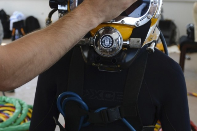 U.S. Army Spc. Michael Brown, 30th Engineer Battalion, 20th Engineer Brigade, 74th Engineer Dive Detachment salvage diver, gets checked before prior to diveing training at Joint Base Langley-Eustis, June 6, 2017. Safety checks are conducted on all equipment before each dive to mitigate any possible risks.