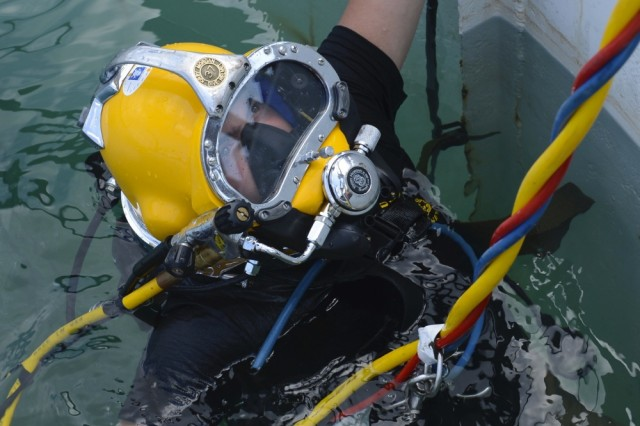 U.S. Army Pfc. James Lewis, 30th Eng. Battalion, 20th Engineer Brigade, 74th Eng. Dive Detachment second-class diver, waits at the surface of the dive- tank for instructions during training at Joint Base Langley-Eustis, June 6, 2017. Lewis, a stand-by diver, practiced rescuing a fellow diver during the training to upgrade his team's proficiency as a unit.