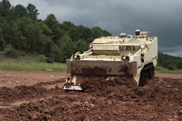Sgt. Ricardo Lindsay, horizontal construction engineer with 252nd Quarter Master Company, 728th Combat Sustainment Support Battalion, 213th Regional Support Group, Pennsylvania Army National Guard, operates an M9 armored combat earthmover during annual training at Fort Indiantown Gap June 7, 2017.