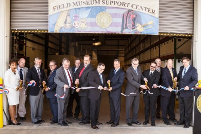 Museum curators from throughout the Army museum system joined Gerald O'Keefe, administrative assistant to the Secretary of the Army, in cutting the ribbon for the Museum Support Center Anniston-North, Anniston, Ala., March 2016.