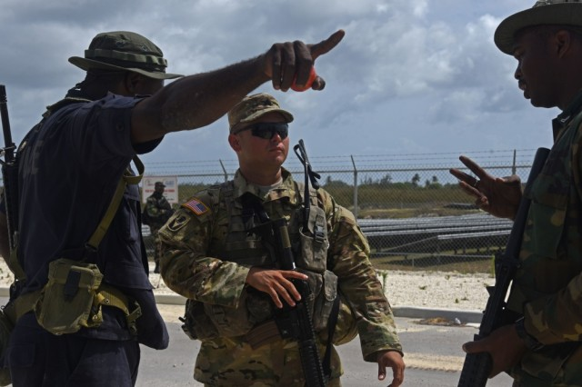 Louisiana National Guard Sgt. Demi Duffy, a healthcare specialist with 2nd Battalion, 156th Infantry Regiment, 256th Infantry Brigade Combat Team helps a member of the Mexico Naval Special Forces in Barbados during Tradewinds 2017, an exercise with 20 nations in the Caribbean. Military personnel and civilians from 20 countries are participating in this year's exercise in Barbados and Trinidad & Tobago June 6-17.