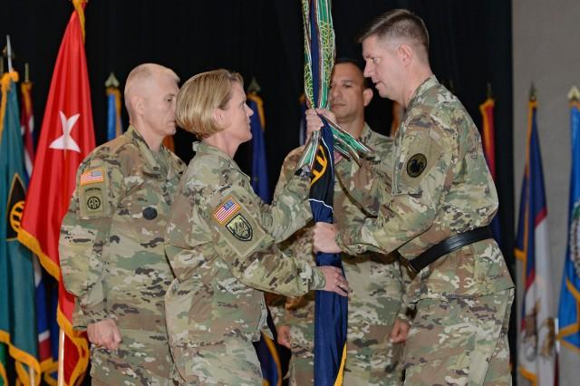 Maj. Gen. Tracy Thompson, deputy commanding general of U.S. Army Reserve Command, passes the unit's colors to incoming 83rd ARRTC commander Col. Kathleen Porter, signifying the transfer of command from former commander Col. Nelson Irizarry, during a ceremony at Waybur Theater on May 31.