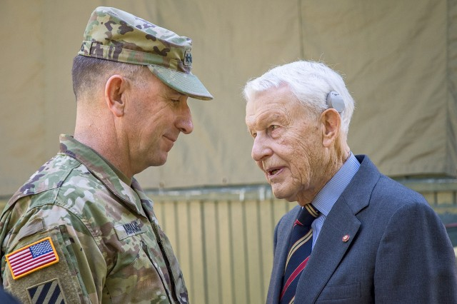 Following graduation ceremonies, Gen. Robert B. (Abe) Abrams, Commanding General U.S. Army Forces Command, talks with retired Lt. Gen. Robert Arter. Arter currently serves as the Civilian Aide to the Secretary of the Army for Kansas. He is also a member of the Fort Leavenworth Hall of Fame and a former deputy commandant of CGSC.
