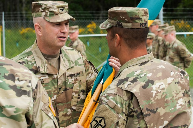 Col. Michael D. Lewis, 301st Maneuver Enhancement Brigade commander, returns the brigade colors to Command Sgt. Maj. Thomas C. Perry, 301st MEB command sergeant major, signifying trust, at the 301st MEB change of command ceremony held at Joint Base Lewis-McChord, Washington June 4, 2017. Founded in 2008, the 301st Maneuver Enhancement Brigade is one of three MEB's in the�Army Reserve. The MEB is a unique multifunctional mission command headquarters designed to perform maneuver support operations for the echelon it supports (U.S. Army Reserve photo by Spc. Sean Harding, 301st Maneuver Enhancement Brigade).